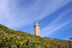 Lighthouse. Old lighthouse and tower on grassy hill. Hercules tower, La Coruna, Galicia, Spain Royalty Free Stock Photography