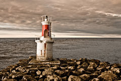 The lighthouse. A lighthouse in a cloudy day, San Vicente, Spain Royalty Free Stock Photo