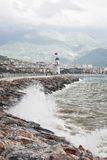 Lighthouse. And stormy sea. Alanya, Turkey Royalty Free Stock Images