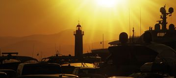 Lighthouse. Of saint tropez with ships in sunset Royalty Free Stock Photography