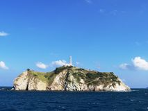 Lighthouse. Island with lighthouse at the entrance to port Santa Marta, Colombia Stock Photos