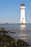Lighthouse. RMS Queen Mary sailing into the river Mersey passing the New Brighton lighthouse Royalty Free Stock Photos