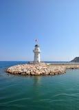 Lighthouse. Turkish lighthouse on a rocky pier Royalty Free Stock Photography