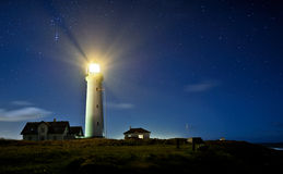 Lighthouse. At night with stars Stock Image