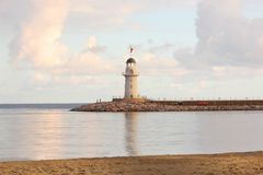 Lighthouse. Beacon against sea sunset. Turkey Stock Images
