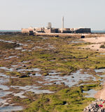 Lighthouse. Surrounded by a castle in the Spanish town of Cadiz, the image was taken at low tide Royalty Free Stock Photos