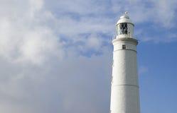 Lighthouse. Against a predominately fair sky Royalty Free Stock Image