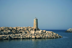 Lighthouse. Stone lighthouse in Tunisia cove Stock Photo