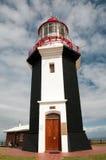 Lighthouse. On the blue sky background Stock Photography
