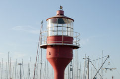 Red lighthouse. Old lighthouse in the harbor Stock Photos