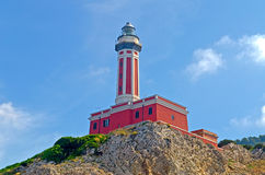 Lighthouse. Red Lighthouse seen on the island of Capri, Italy, shot from a boat stock photos