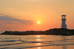 Lighthouse with sunset of thailand sea Stock Image