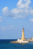 Lighthouse. A lighthouse with large sky area and some clouds. This lighthouse is in Alexandria, Egypt Stock Photography