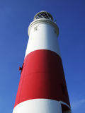 Lighthouse. Details of a tall, red and white lighthouse.  Dorset, England Stock Photography