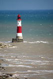 Lighthouse. Guarding dangerous rocks at beachy head Stock Photos