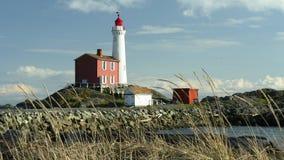 Lighthouse. Beautiful Fisgard lighthouse setting on the coast of Vancouver Island Royalty Free Stock Photos