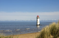Lighthouse. In the sea framed by long grass and sand dunes Royalty Free Stock Photos