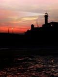 Lighthouse. After sunset under colorful sky Stock Photo