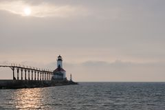 Lighthouse. Sunset and lighthouse at lake Michigan Stock Photography