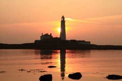 Lighthouse. Sunrise at Saint Mary's Island and Lighthouse, nearby to Whitley Bay. On the coast of Northeast England Royalty Free Stock Photo