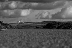 Lighthouse. In the horizon, in Menorca Stock Images