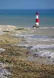 Lighthouse. Light  house at foot of beachy head cliffs Royalty Free Stock Photos