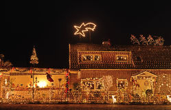 Lighthouse. A house lit to the max at X-mas Stock Photos