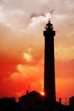 Lighthouse. At sunset under colorful sky Stock Images