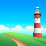Lighthouse. At the summer meadows in sunny day Royalty Free Stock Photography