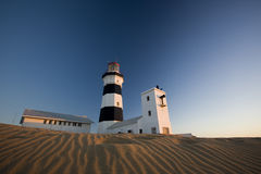 Lighthouse. A photograph of a lighthouse at Cape Recife, Port Elizabeth, South Africa at sunrise Royalty Free Stock Images