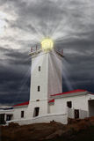 Lighthouse. Against dramatic sky with beams of light Royalty Free Stock Images