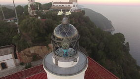Lighthouse Aerial Shot View at Sunset stock video footage