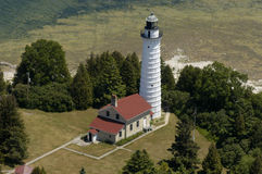 Lighthouse Aerial View. Lighthouse photographed during a fly by from an airplane. This is the Cana Island Lighthouse in Door County, Wisconsin, on Lake Michigan royalty free stock image