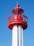 A lighthouse against a blue sky background Royalty Free Stock Photo