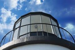 Lighthouse against a blue sky Royalty Free Stock Photos