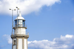 Lighthouse against blue sky and clouds Royalty Free Stock Photography