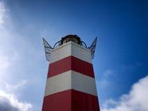 Lighthouse against blue sky Stock Photography
