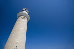 Lighthouse against clear blue sky stock images