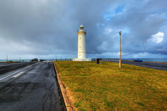 Lighthouse against dramatic sky Royalty Free Stock Photo