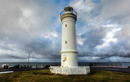Lighthouse against dramatic sky Stock Photos