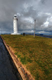 Lighthouse against dramatic sky Stock Images