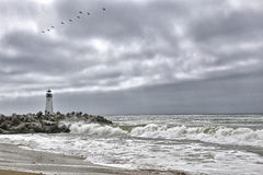 Lighthouse against the sky while stormy weather Stock Photo
