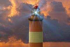 A lighthouse against a sunset. 3D rendering of a lighthouse against a sunset royalty free illustration