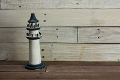 Lighthouse against a wood background Stock Image