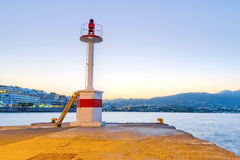 Lighthouse of Agios Nikolaos city at sunset Stock Images