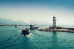 Lighthouse in Alanya, Turkey. Ships are walking along the Mediterranean Sea near the Lighthouse royalty free stock photos