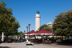 Lighthouse in Alexandroupolis - Greece. ALEXANDROUPOLIS, GREECE - AUGUST 18: The hallmark of the city which is the lighthouse, surrounded with cafeterias and Royalty Free Stock Photography