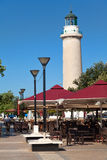 Lighthouse in Alexandroupolis - Greece. ALEXANDROUPOLIS, GREECE - AUGUST 18: The hallmark of the city which is the lighthouse, surrounded with cafeterias and Stock Image
