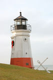 Lighthouse and anchor. On the banks of Lake Eerie Royalty Free Stock Image