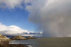 Lighthouse and approaching storm. Mumbles lighthouse, Swansea with approaching storm Royalty Free Stock Photos